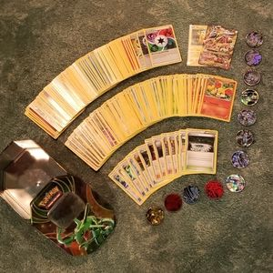 Pokemon card set with coins and tin